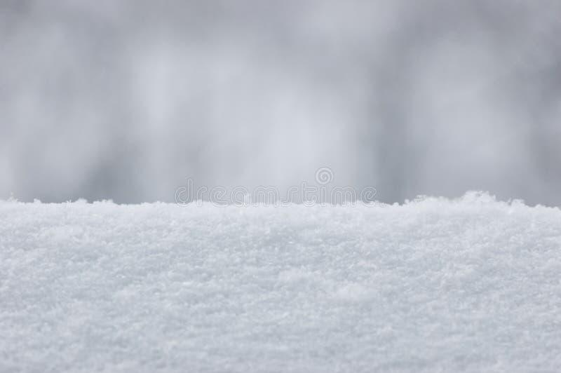 Предпосылка текстуры снега, большой детальный горизонтальный крупный план макроса, нежное Bokeh стоковые изображения