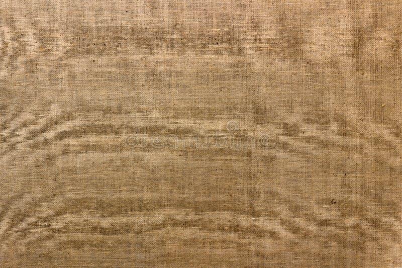 Предпосылка текстуры холста джута Брайна естественная стоковая фотография rf