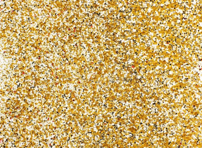 Предпосылка текстуры яркого блеска золота, предпосылка праздника искры стоковые фото