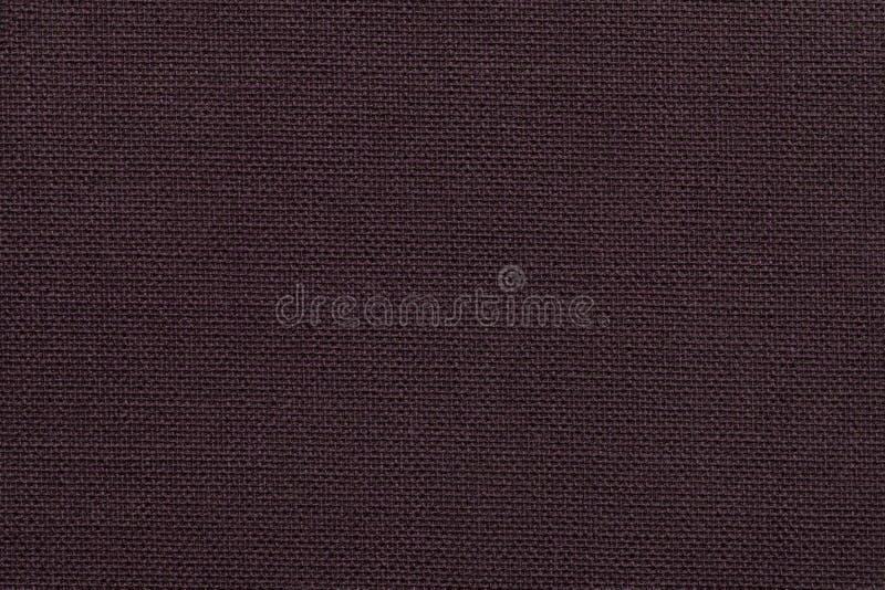 Предпосылка темного коричневого цвета от материала ткани с плетеной картиной, крупным планом стоковая фотография