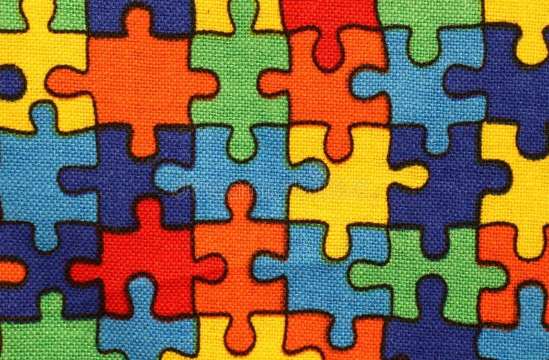 предпосылка ткани с частями головоломки стоковое изображение