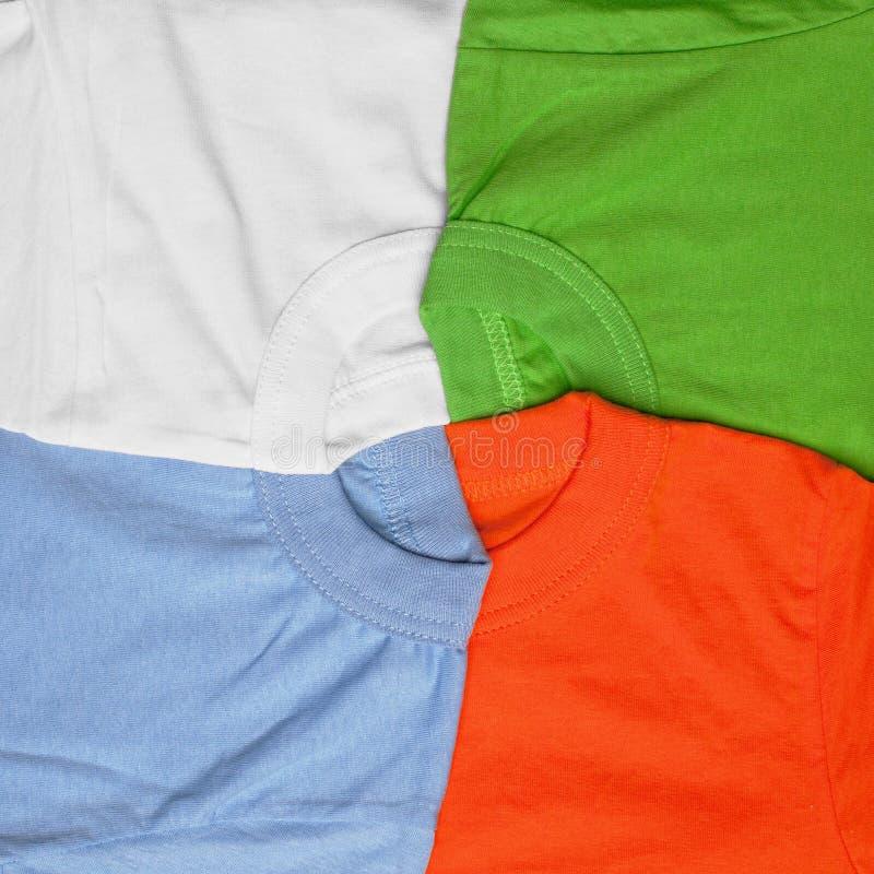 Предпосылка футболок творческая стоковое изображение