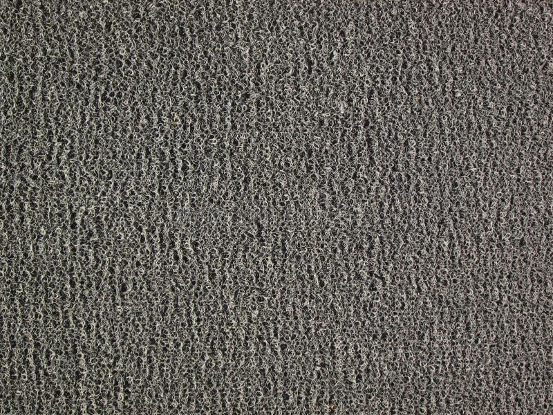 Предпосылка черной текстуры ковра или шабера или коврика у входной двери ноги стоковые изображения rf