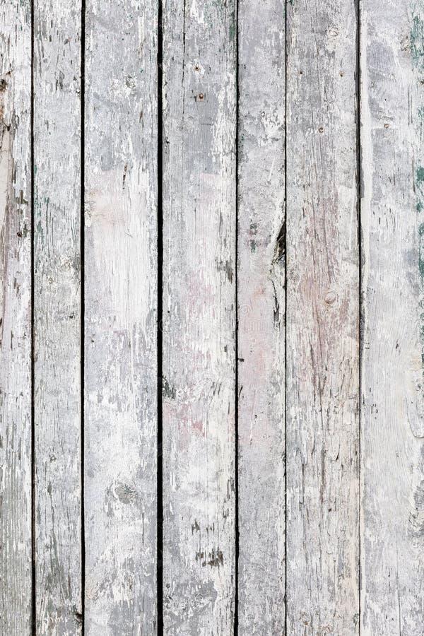Предпосылка Grunge деревянной текстурированная стеной старые покрашенные доски белыми стоковые изображения rf