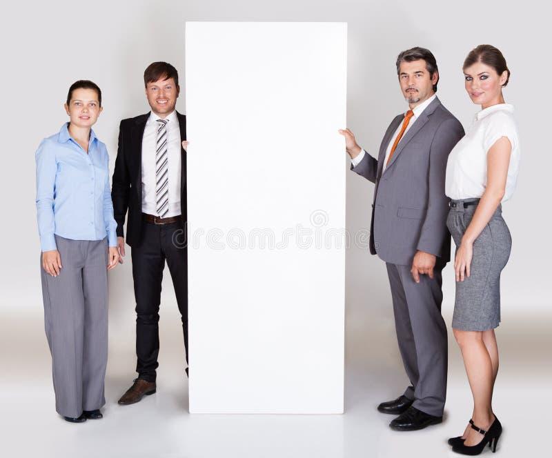 Предприниматели проводя плакат стоковое изображение rf