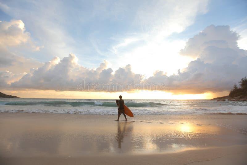 Прибой и заход солнца стоковое фото