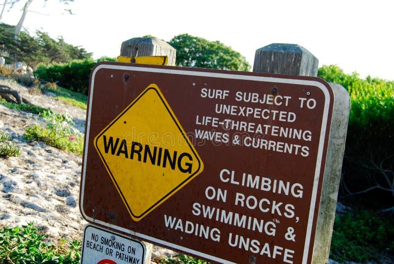 Прибой предупредительного знака опасный стоковое изображение rf