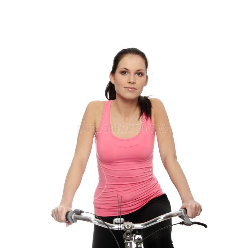 привлекательная женщина брюнет bike стоковое фото rf
