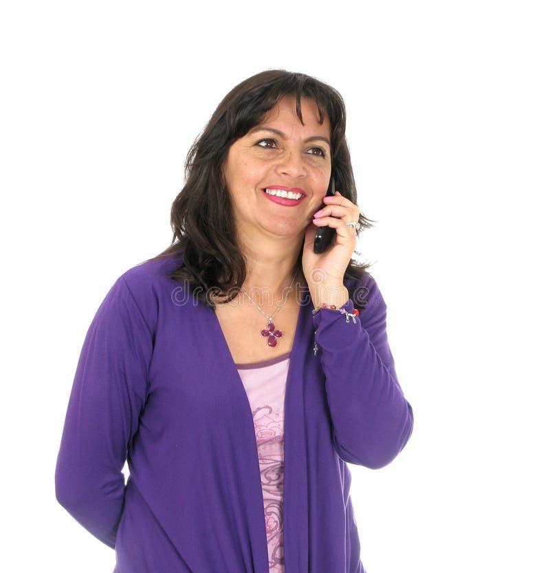 привлекательная женщина мобильного телефона удерживания стоковое фото rf