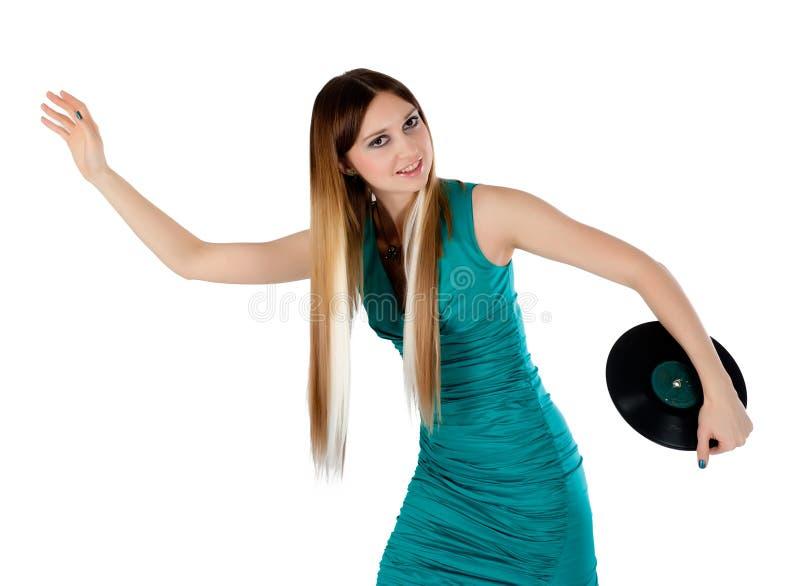 Привлекательная женщина с диском винила стоковые изображения