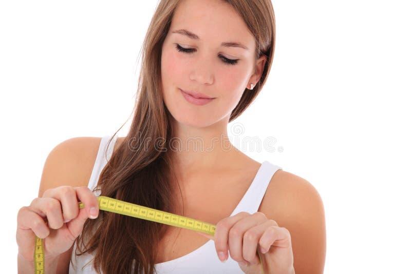 Привлекательная женщина с измеряя лентой стоковое фото rf