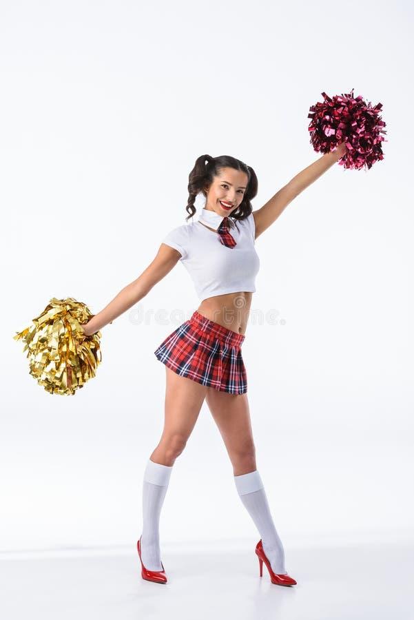 привлекательная молодая школьница с pompoms чирлидера стоковые изображения