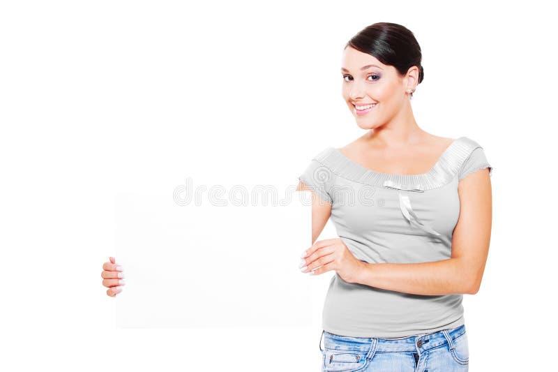привлекательная пустая пустая женщина smiley удерживания стоковое изображение