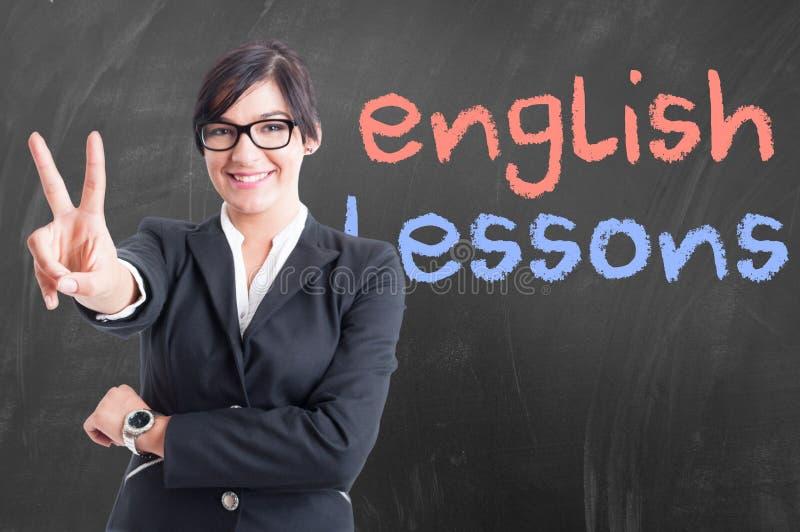 Привлекательный молодой учитель принимая ее английский урок стоковое изображение
