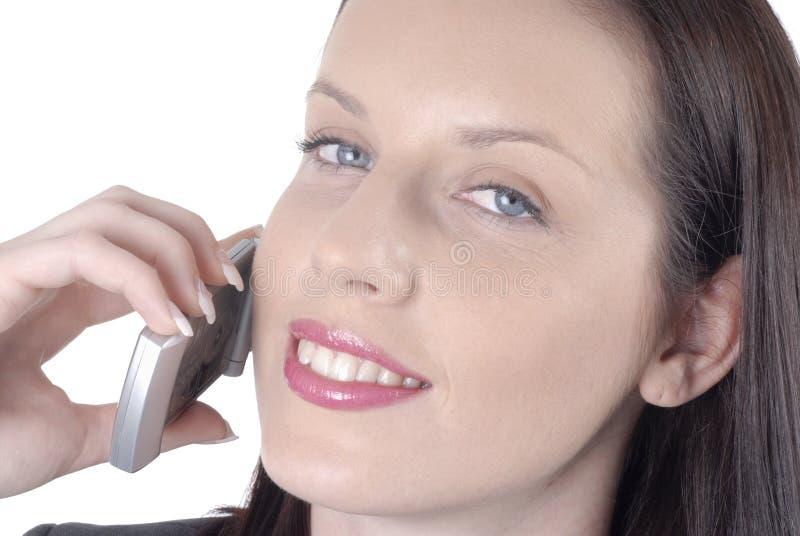 Привлекательная бизнес-леди с мобильным телефоном стоковое изображение rf