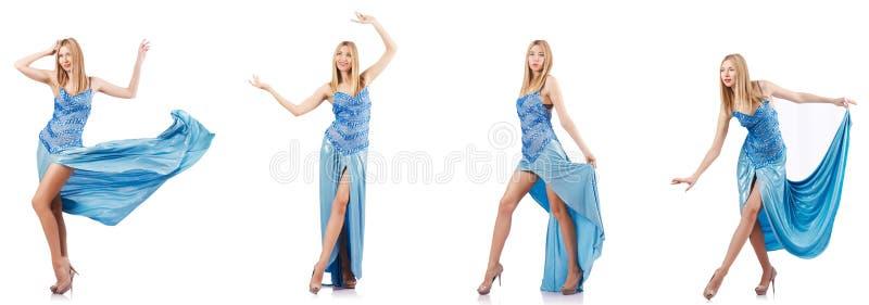 Привлекательная женщина в голубом платье на белизне стоковая фотография rf