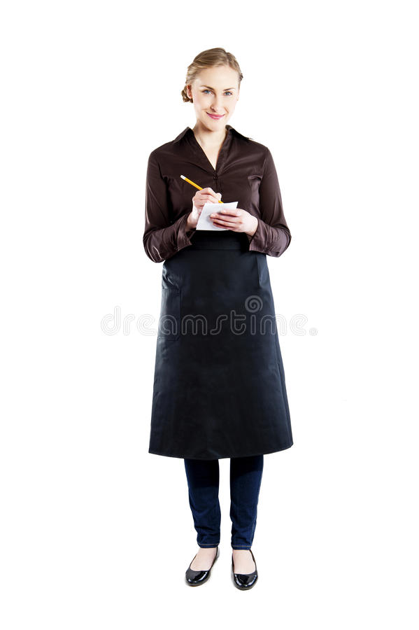Привлекательная молодая официантка на белой предпосылке стоковые изображения