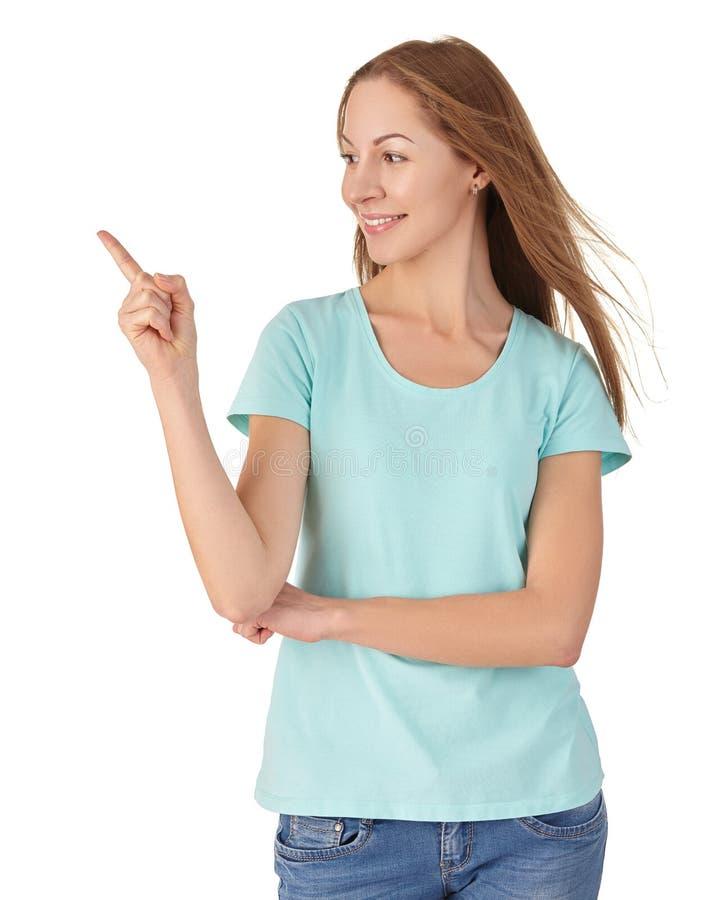 Привлекательные улыбки и пункты девушки палец стоковые фотографии rf