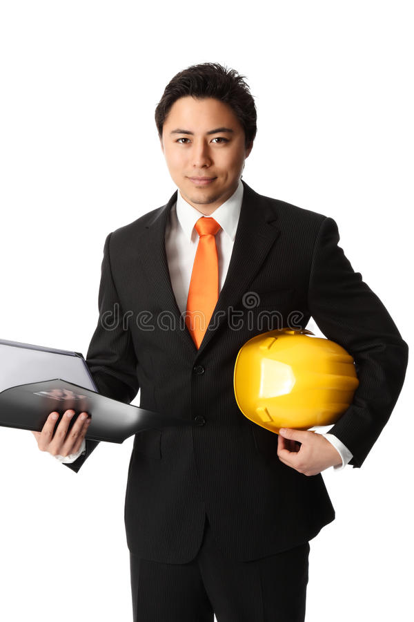 Привлекательный мастер в защитном шлеме стоковое фото