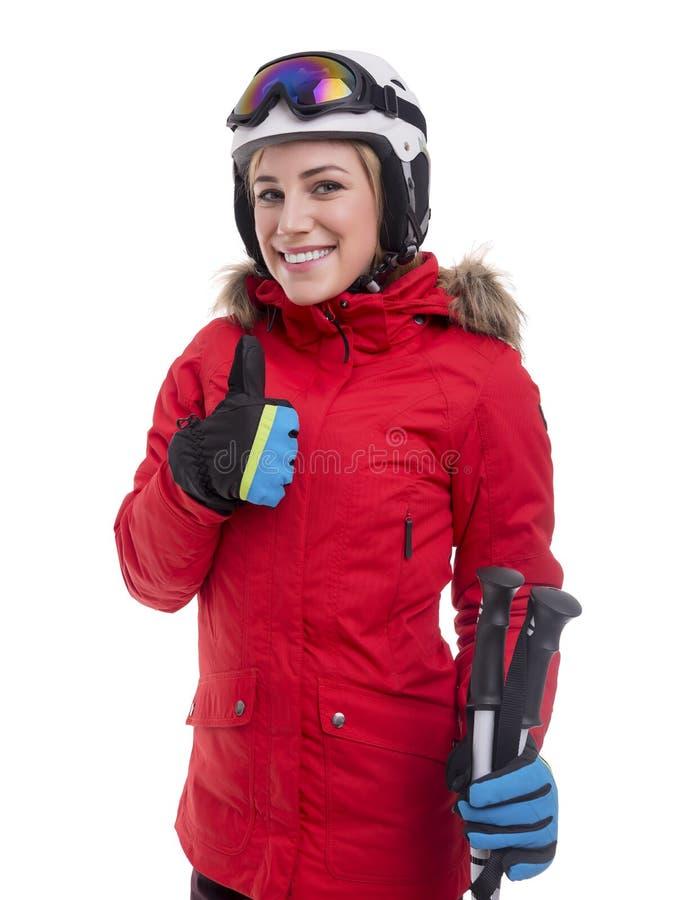 Привлекательный лыжник девушки на белой предпосылке стоковые изображения rf