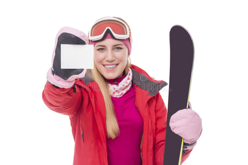 Привлекательный лыжник девушки на белой предпосылке стоковое фото