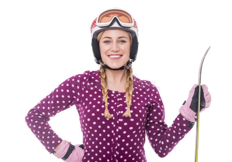 Привлекательный лыжник девушки на белой предпосылке стоковые фотографии rf