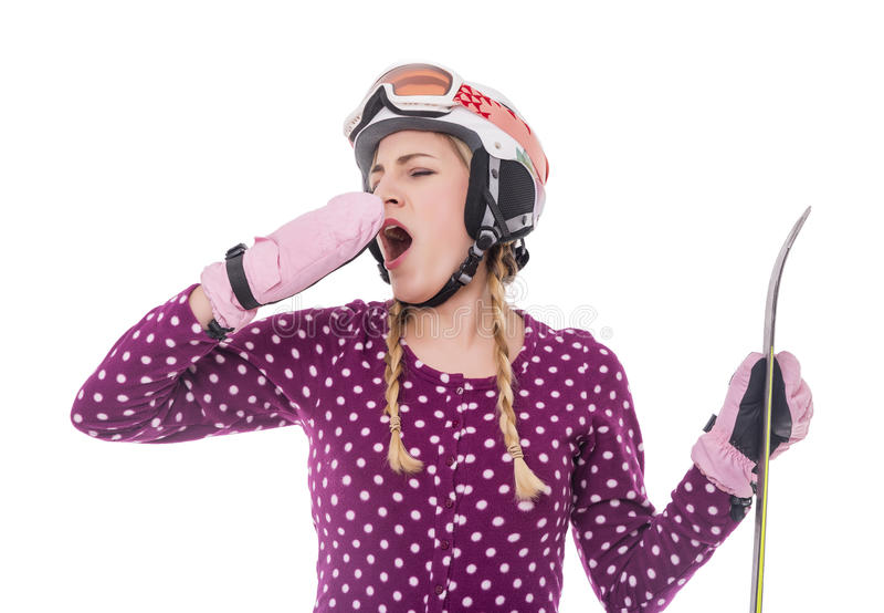 Привлекательный лыжник девушки на белой предпосылке стоковое изображение rf