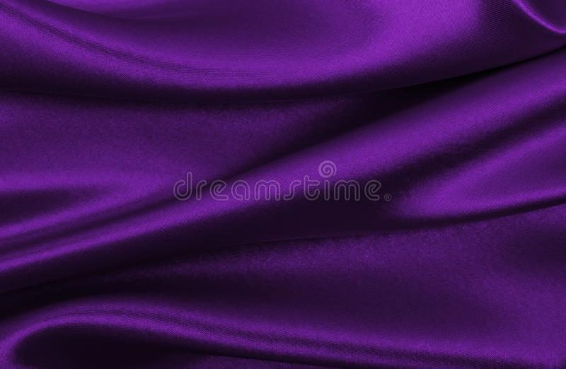 Приглаживайте элегантную текстуру ткани шелка или сатинировки сирени роскошную как abstr стоковое фото