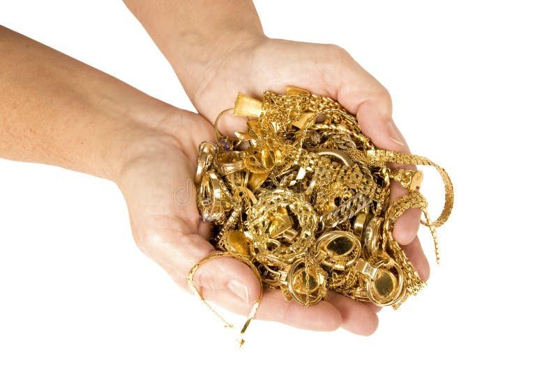 Пригорошня золота готовая для того чтобы продать для наличных дег стоковое изображение rf