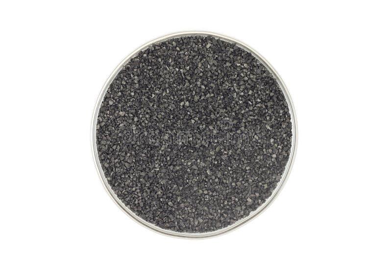 Пригорошня угля в стеклянной чашке стоковые изображения rf