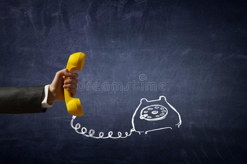 Приемник телефона в руке стоковые фото