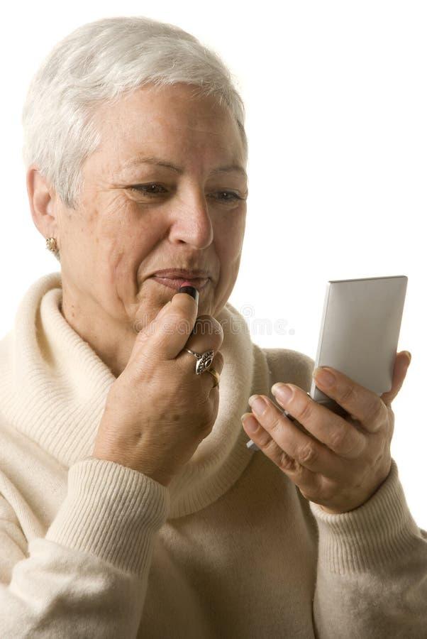 прикладывать женщину губной помады стоковые фотографии rf