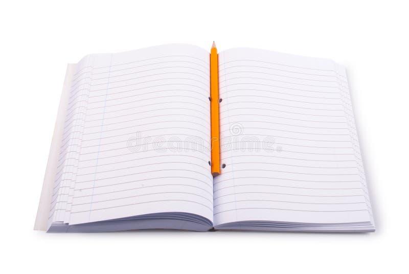 прикройте карандаш тетради стоковое фото