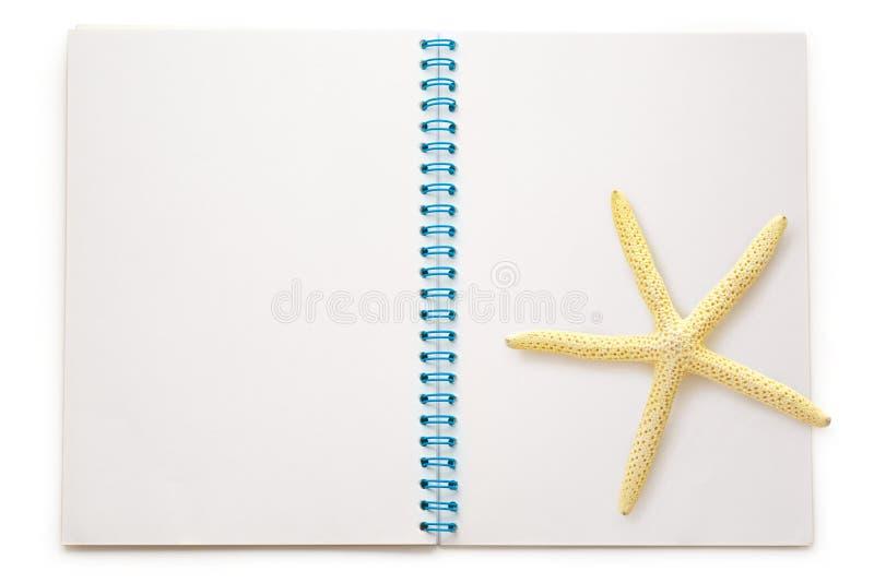 Прикройте открытый блокнот с морской звездой стоковое фото rf
