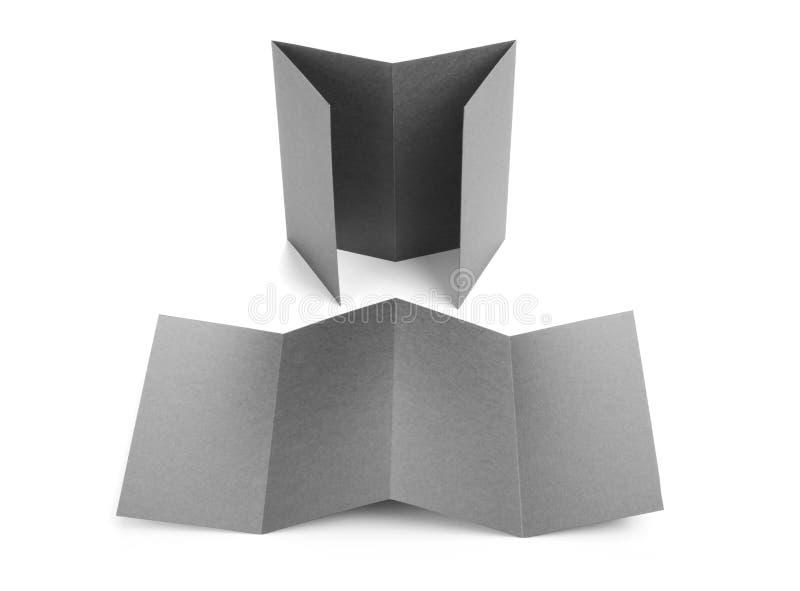 Прикройте сложенный бумажный модель-макет листовки или рогульки стоковая фотография rf