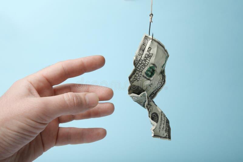 Приманка денег поглотила Успех в бизнесе и опасность Зависимость задолженности стоковые фотографии rf