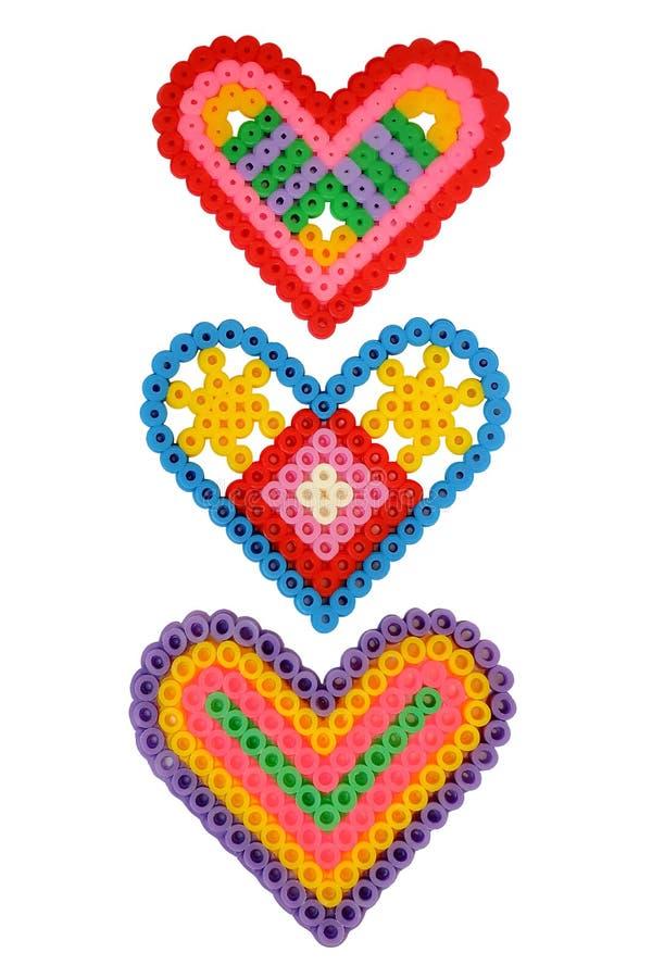 Применение 3 сердец в форме указателя изолированного на белой предпосылке стоковые фотографии rf