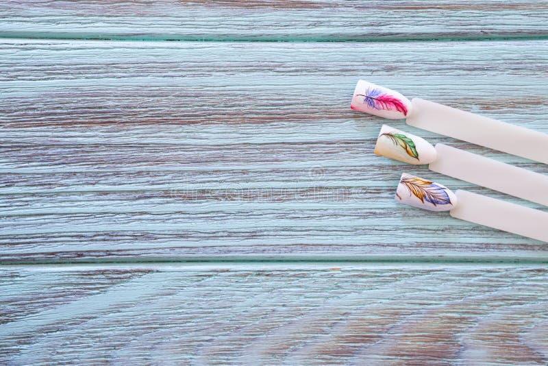 Примеры чертежей на ногтях стоковые изображения