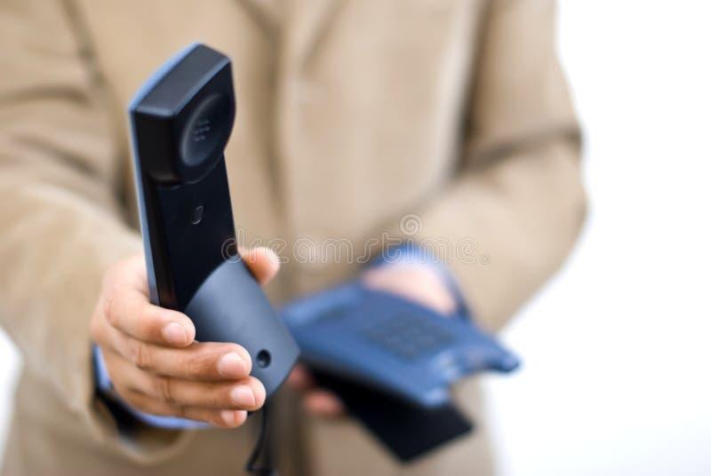 принимать телефона менеджера по вызову стоковые фото