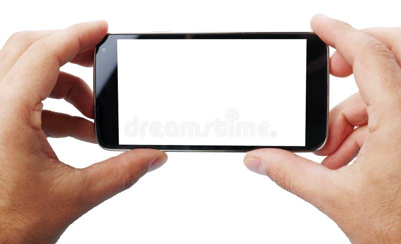 Принимать фото с мобильным телефоном стоковое фото