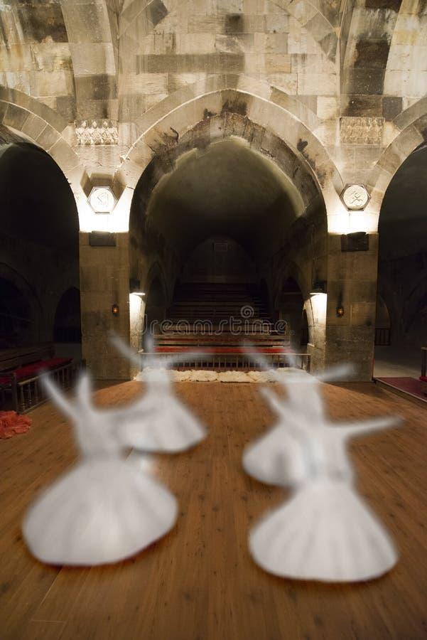 Принципиальная схема завихряясь Dervish, средняя восточная культура Sufi стоковая фотография rf