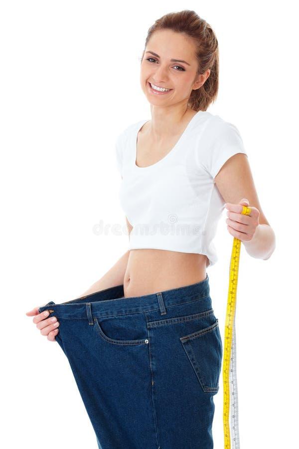 принципиальная схема diet ее женщина выставок огромных джинсыов старая стоковая фотография