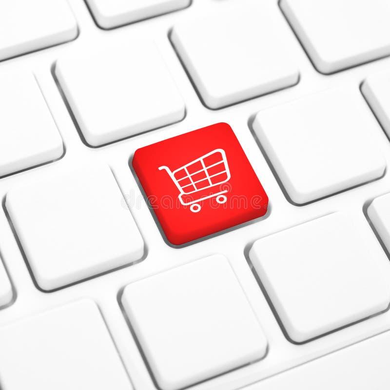 Принципиальная схема дела магазина онлайн. Красная кнопка или ключ магазинной тележкаи на клавиатуре стоковые изображения rf