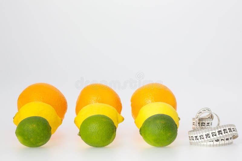 Цитрусовые фрукты и измеряя лента стоковые изображения rf