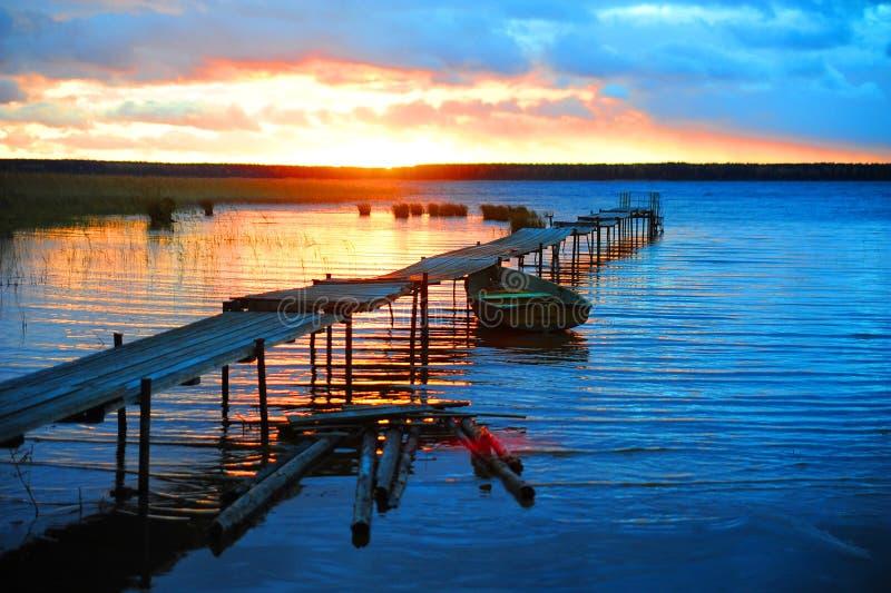 Пристань на заходе солнца стоковое фото rf