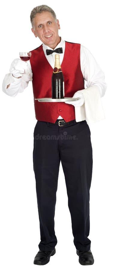 Причудливый головной кельнер держа бутылку вина изолированный стоковые фотографии rf