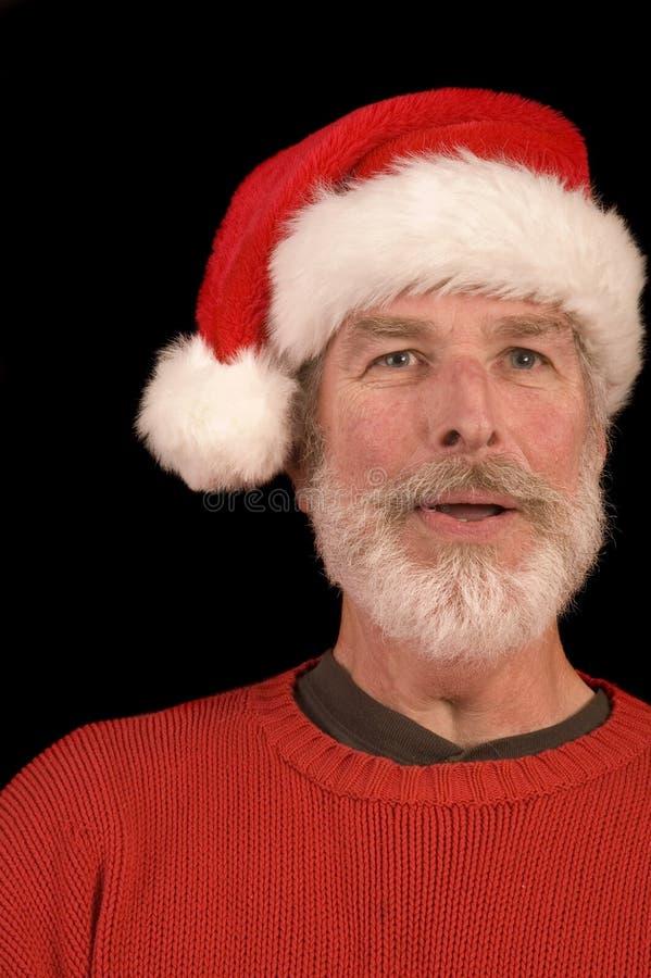 Приятный человек в шлеме Санта стоковые фотографии rf