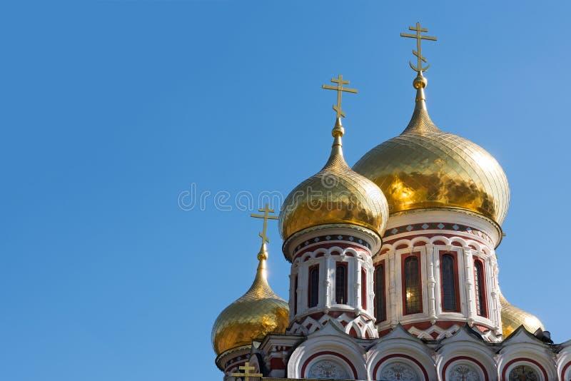 придает куполообразную форму: золотистое стоковое изображение