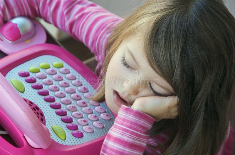 пробуренный компьютер ребенка стоковая фотография
