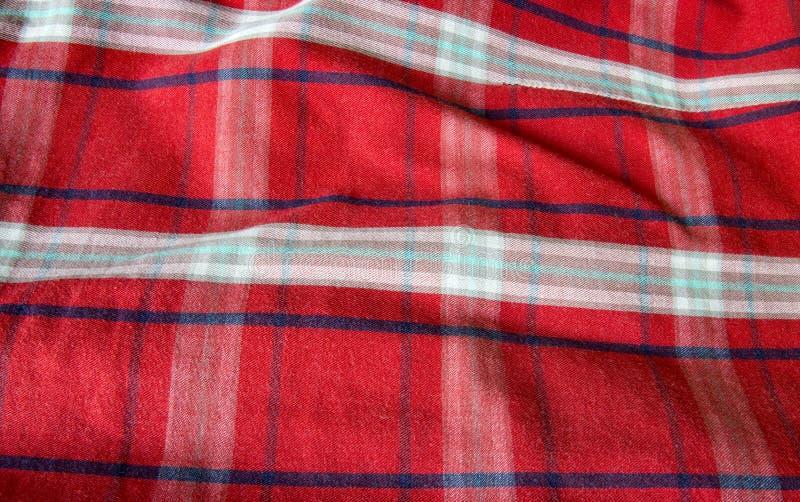 Проверенная красным цветом предпосылка ткани стоковое изображение rf